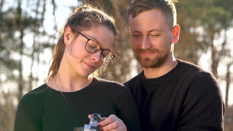 Young couple in love taking photo of themself on a film camera Footage