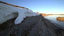 Melting snow and ice on wilderness desert coast in Arctic Ocean on New Earth Footage