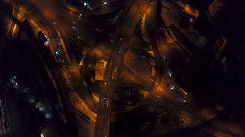 Vertical top down aerial view of traffic on freeway interchange at night Live影片