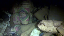 Personal things of dead people on underwater shipwreck Salem Express Footage