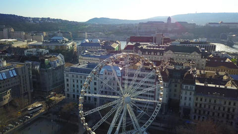 Flying by Budapest Eye at Deak Square with Buda Castle Royal Palace Footage