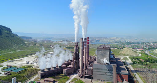 Aerial view of steam, smoke from pipes at a thermal power station. Aerial view Live Action