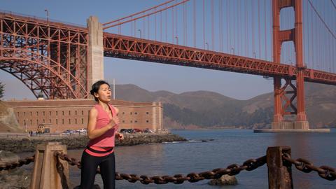 Woman Jogging Golden Gate Footage