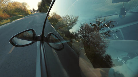 Point of View Man Driving car at Sunset Live Action