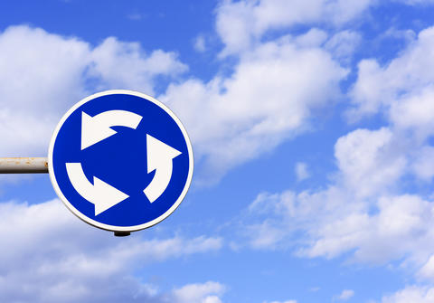 traffic sign circular motion on blue sky background Photo