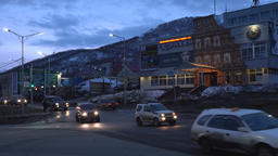 Evening view of building of entertainment center, cars driving on city road Footage