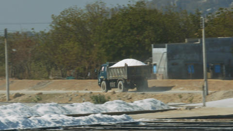 Salt Truck Drives along Road by Extraction Fields Footage