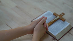 woman hands praying to god with the bible. Woman Pray for god blessing to GIF