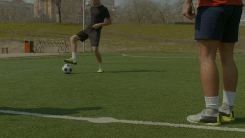 Young soccer players training football on the pitch GIF