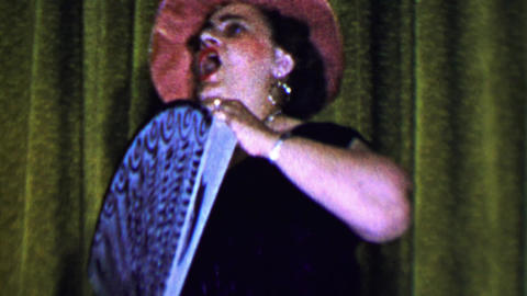 1957: Women theatrical performance art storytelling with a big fan Footage
