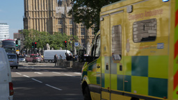 An ambulance speeds through Parliament Square in London to an emergency. Shot in Footage