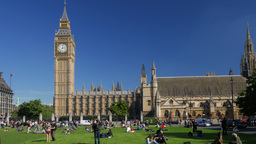 Tourists On The Grass Of Parliament Square In London On A Sunny September Aftern stock footage