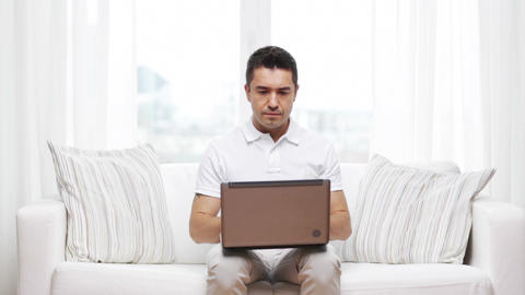 man working with laptop computer at home Footage