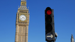 Traffic lights with Big Ben and Parliament behind. Shot in 4K on sunny September Footage
