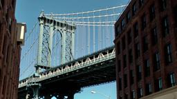 New York City 597 Manhattan Bridge between buildings of Brooklyn Footage