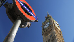 Tilt shot of the London Underground logo with Big Ben behind. Shot on a sunny Se Footage