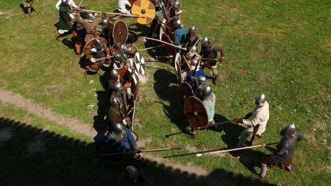 Viking warriors battle line on line, formation approach, attack by spear and axe Live Action