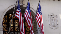 New York City 554 stars and stripes flags over hotel entrance Footage