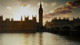 Pan from the Houses of Parliament to Westminster Bridge at sunset. Shot on a cle Footage