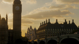 Tilt shot down Big Ben to the River Thames as the sun sets behind parliament Footage