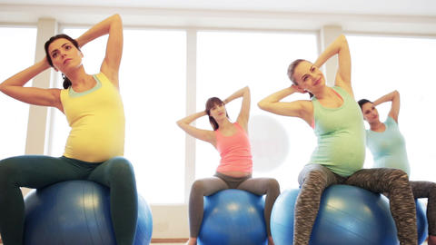 happy pregnant women exercising on fitball in gym Footage
