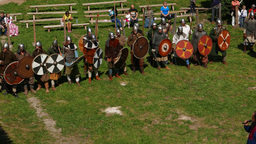 Viking warriors stand in line, round shield protect spear line of fighters Live Action
