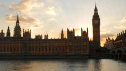 Camera pans across the facade of Parliament to Westminster Bridge in London and  Footage