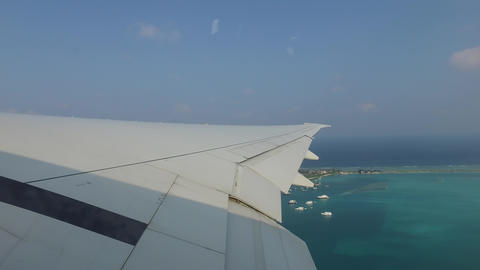 wing of airplane flying above ocean Footage