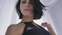 Portrait of young sexy caucasian brunette in black lingerie, looking down, bare Footage