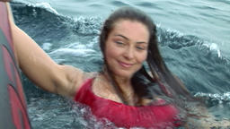 Free diver model in a red dress in water in Red Sea Footage