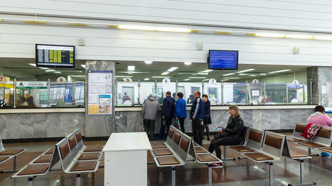Passengers Wait for Transport in Waiting Room Footage