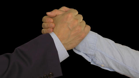 Two hands joining together after deal. Businessman and businesswoman shaking Footage