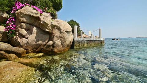 Clear water in Capriccioli beach in Costa Smeralda. Sardinia, Italy Live Action