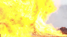 Stunt girl in a fiery explosion Footage