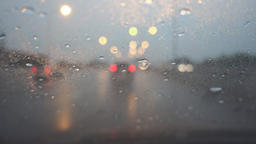 Driving on freeway and rainy in twilight, rack focus Footage