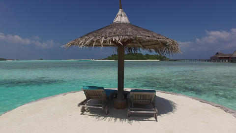 palapa and sunbeds by sea on maldives beach Footage