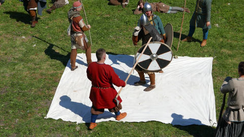 Two Viking fight at white blanket, single combat, duel fight with judges Live Action