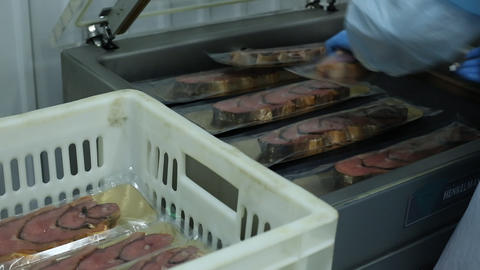 Vacuum packaging of fish preserves at factory Footage