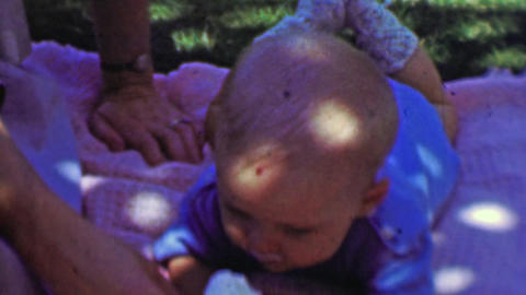 1957: Newborn baby eating ice cream cone summer picnic blanket Footage