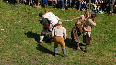 Fun competition, drag rope battle, three man teams during Viking age show Footage