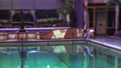 1958: Hotel resort pool lounge chair relaxation vacation fun zone Footage