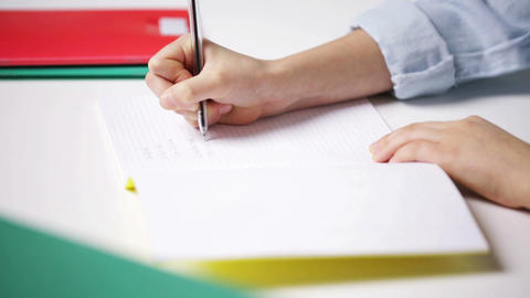 school girl hand writing math task to notepad Footage