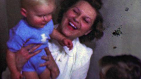 1958: Mom enjoys kid brothers kissing bedtime goodnight Footage