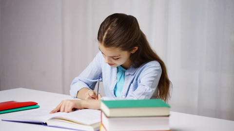happy school girl with books and notepad at home Footage