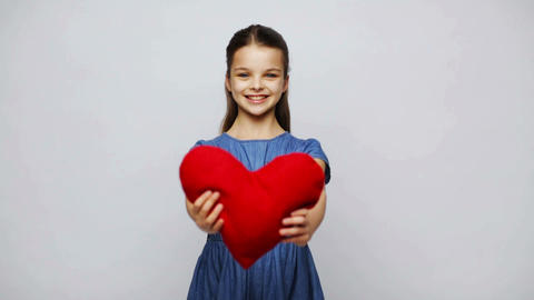 happy smiling girl with red heart shaped pillow Footage