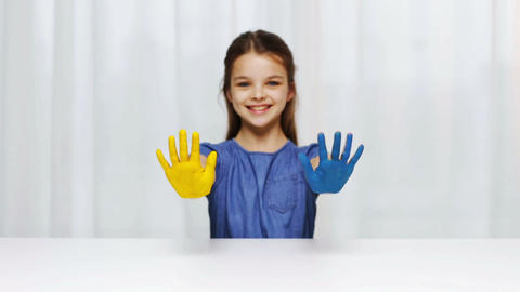 smiling girl showing painted hands Footage