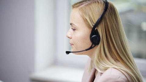 businesswoman with headset talking at office Footage
