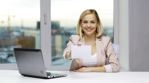 businesswoman showing blank paper card at office Footage