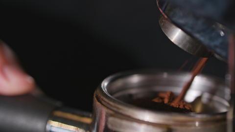 Coffee Grinder Grinding Freshly Roasted Beans Photo