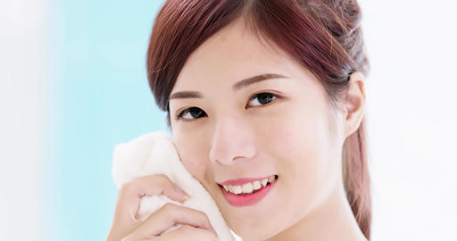 woman use towel clean face Footage